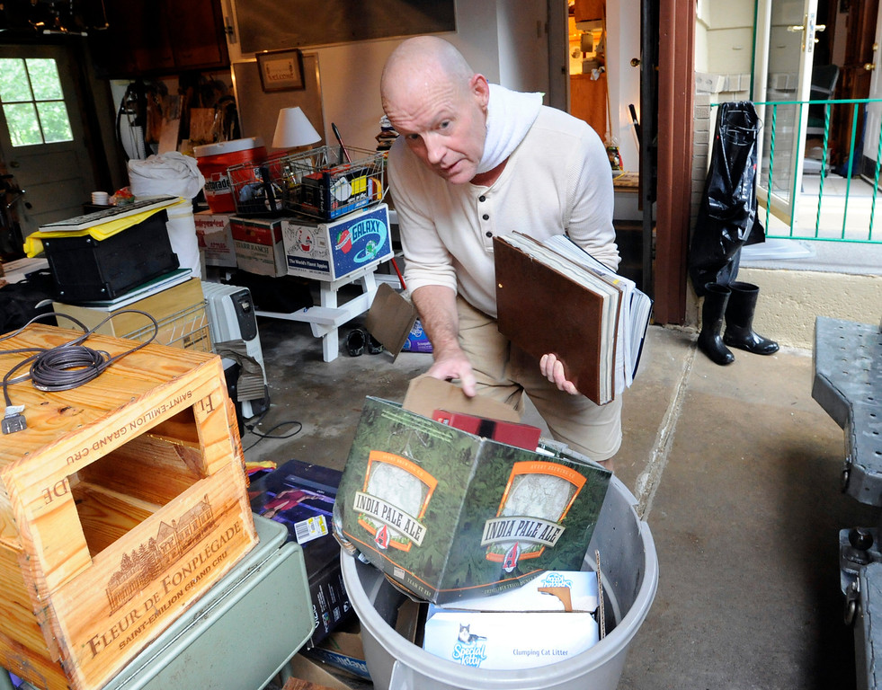 . Robert Rea III is organizing items from his father\'s basement. Bob Rea, of Boulder, his family and friends, have been pumping water and cleaning the basement of their home since 9 pm last night. For more flooding videos and photos, www.dailycamera.com. Cliff Grassmick  / September 12, 2013