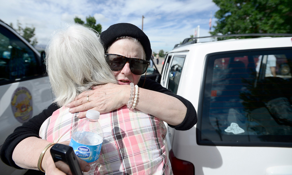 . Deborah Haynes (right) hugs close friend, Judy Potter (left), after being helicoptered down from James town at Boulder Municipal Airport in Boulder, Colorado September 13, 2013. Haynes said Jamestown has been very hard hit from the flooding.  BOULDER DAILY CAMERA/ Mark Leffingwell