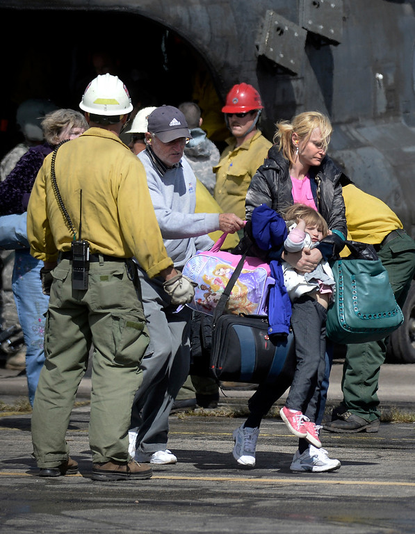 . Pavlina Kushierz carries her daughter Izabella off the helicopter after being rescued from the flooding at Pinewood Springs on Monday, Sept. 16, at the Boulder Municipal Airport in Boulder. For more photos and video of the flood rescue go to www.dailycamera.com Jeremy Papasso/ Camera