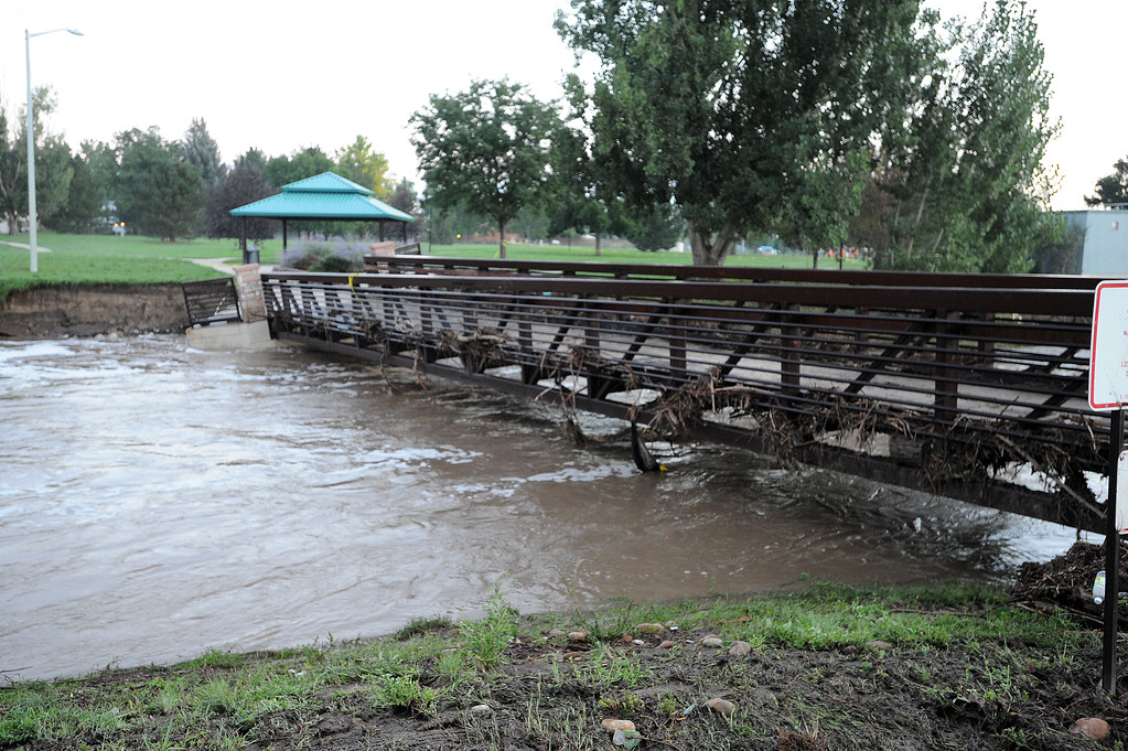 . A bridge at Kanemoto Park was damage from flood water from Lefthand Creek in Longmont. Cliff Grassmick / September 14, 2013