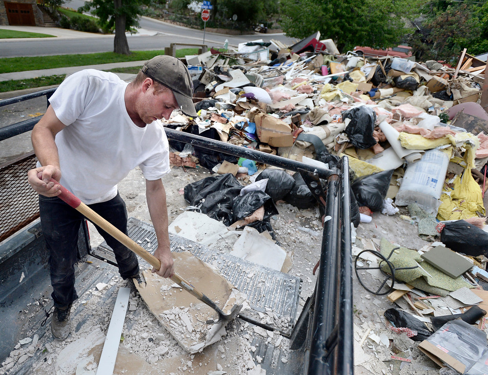 . Andy Morgan disposes of flood damaged drywall from his grandfather\'s Boulder home at the North Boulder Park on Wednesday, Sept. 18, in Boulder. For more photos and video of the flood go to www.dailycamera.com Jeremy Papasso/ Camera