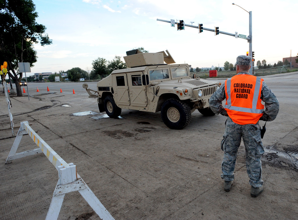 . National Guard troops stationed at  S. Main Street and Missouri at sunrise of Saturday morning. The guards wouldn\'t give names.  A total of 56 Colorado National Guard have been stationed with 28 Humvees at traffic control points throughout Longmont, Colorado on September 14, 2013. Cliff Grassmick / September 14, 2013