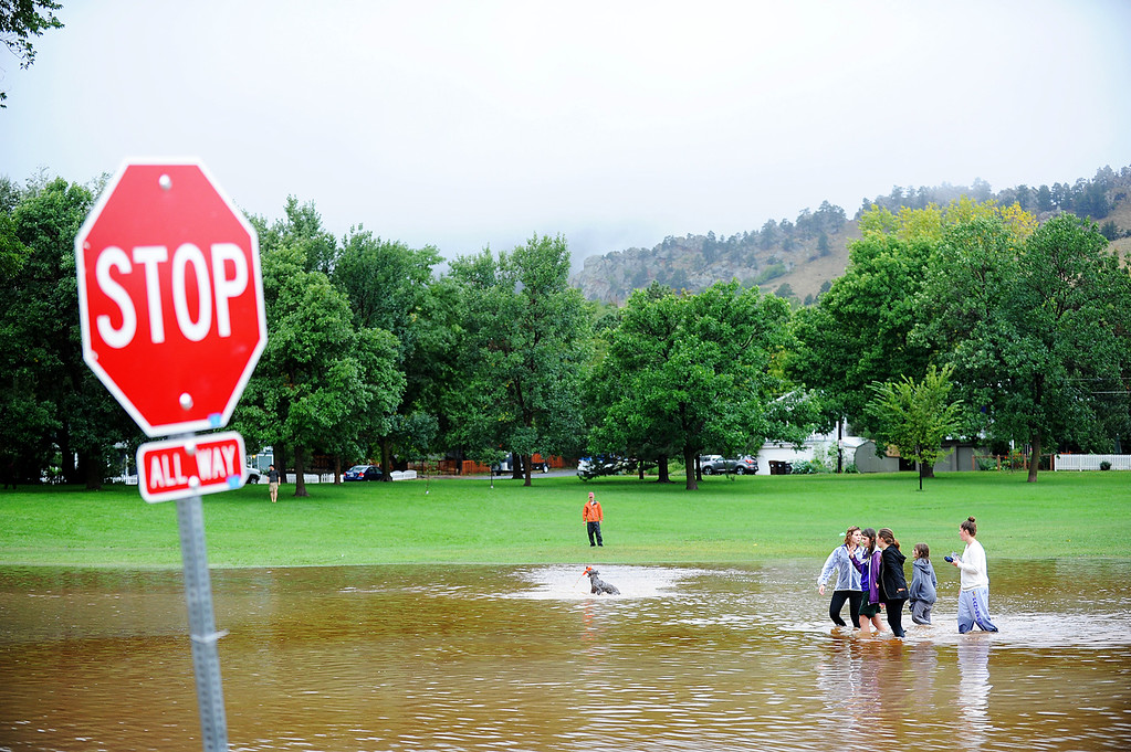 . Flood waters saturated North Boulder Park and pooled up at the corner of Balsam and 9th Street in Boulder on Thursday, September 12, 2013. (Kira Horvath/ Daily Camera)