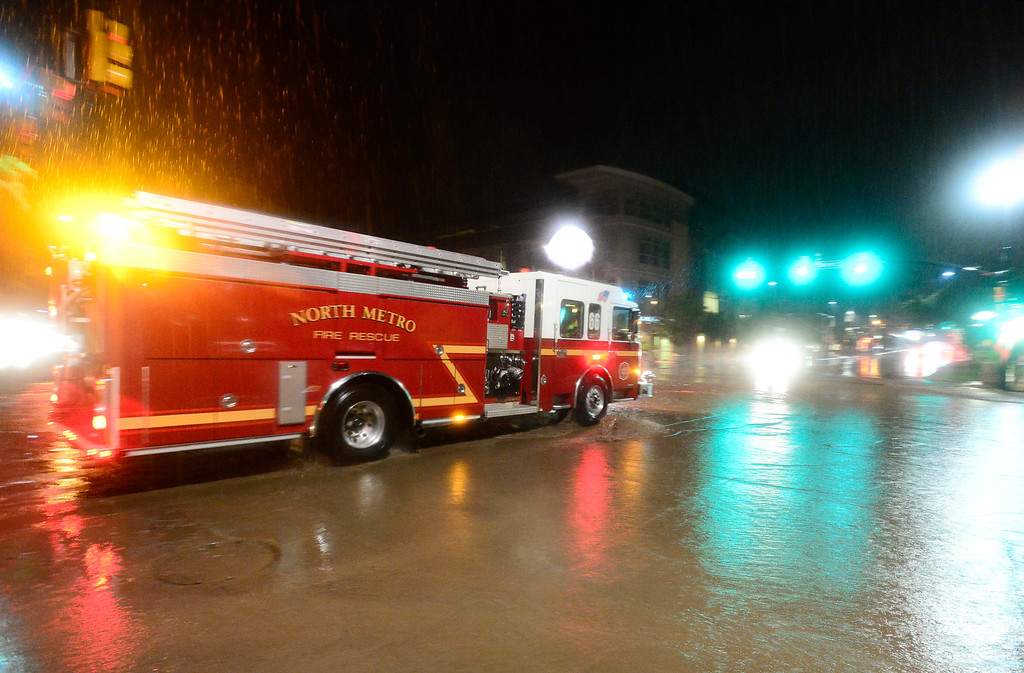 . A North Metro Fire Rescue truck passes through the flooded intersection of Canyon and 13th, Thursday, Sept. 12, 2013, in Boulder. (Matthew Jonas/Times-Call)