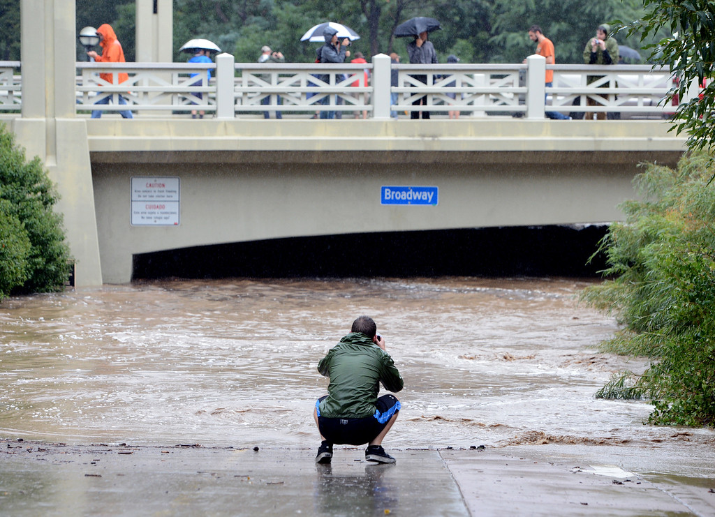 . A man photographs the flooding in the underpass at Boulder Creek and Broadway. For more flooding videos and photos, www.dailycamera.com. Cliff Grassmick  / September 12, 2013