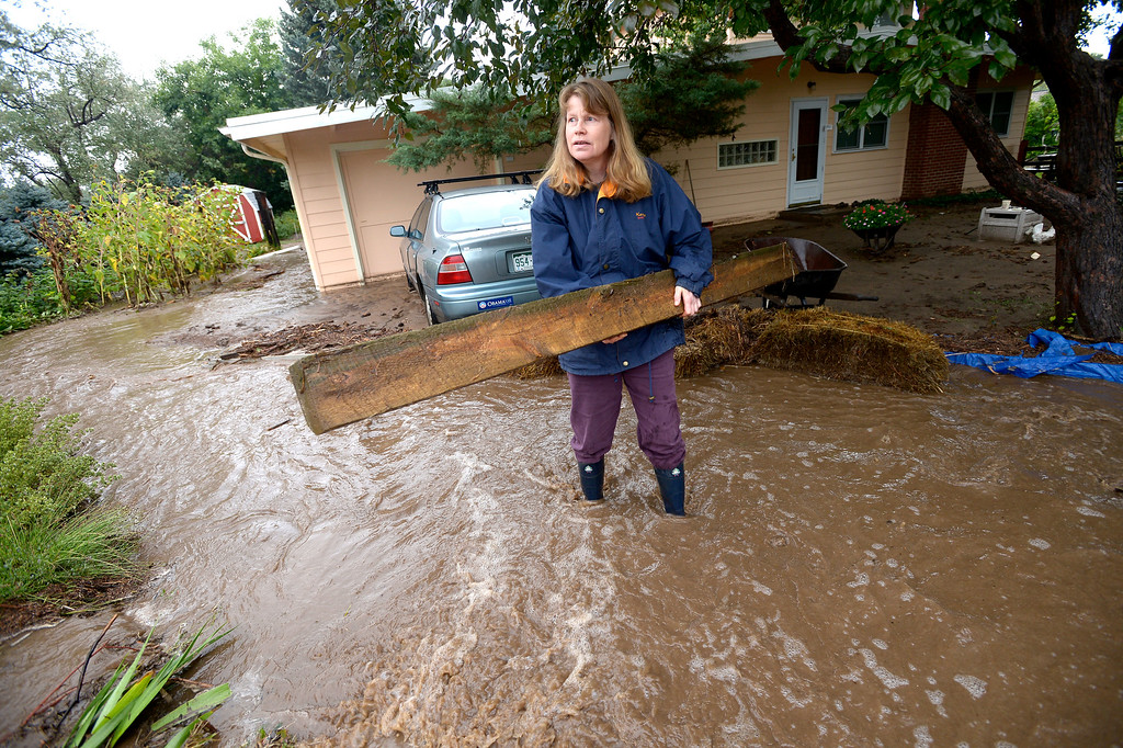 . Kent Shorrock and his wife Astrid Paustian uses straw bales and timber to keep water from their home in North Boulder of Violet Avenue on Friday September 13, 2013 ....Photo by Paul Aiken / The Daily Camera