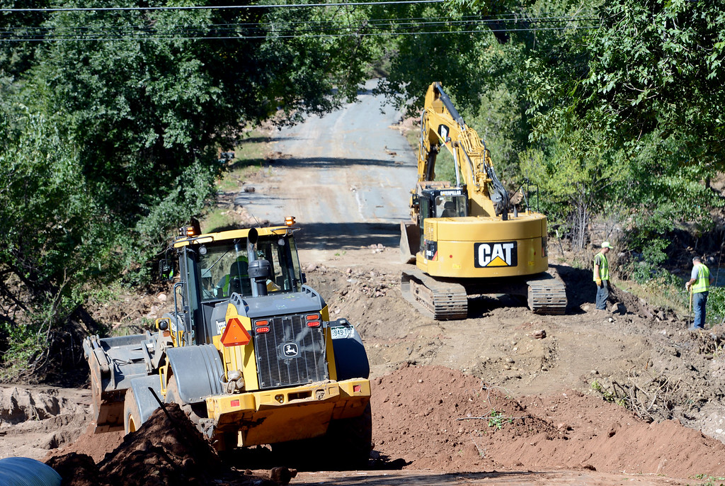 . Boulder County Road crews repair a washed out road off Lee Hill Drive at Wagonwheel Gap Road so that Xcel can begin work on gas and power lines. For a video of the construction, go to www.dailycamera.com. Cliff Grassmick  / September 20, 2013