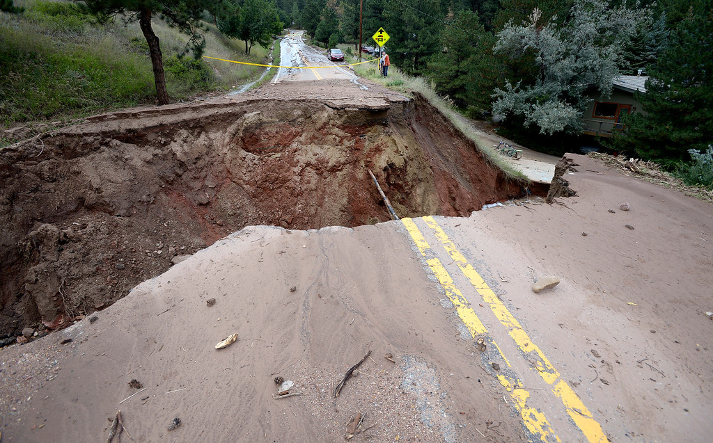 . North Cedar Brook Drive is broken by a large infall in Pine Brook Hills on Friday September 13, 2013 ....Photo by Paul Aiken / The Daily Camera