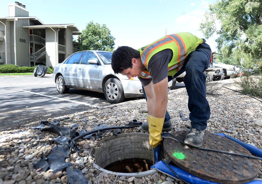 . Travis Poland, of Quality Pipe Services, pumps ground water out of a sewer line at the Manhattan West Apartments on Wednesday, Sept. 18, in Boulder. For more photos and video of the flood go to www.dailycamera.com Jeremy Papasso/ Camera