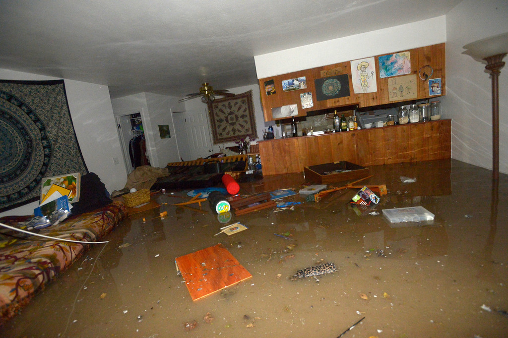 . A flooded room in the the Aspen Grove Apartments off Kalmia Ave in north Boulder Thursday morning.  Photo by Paul Aiken / www.dailycamera.com