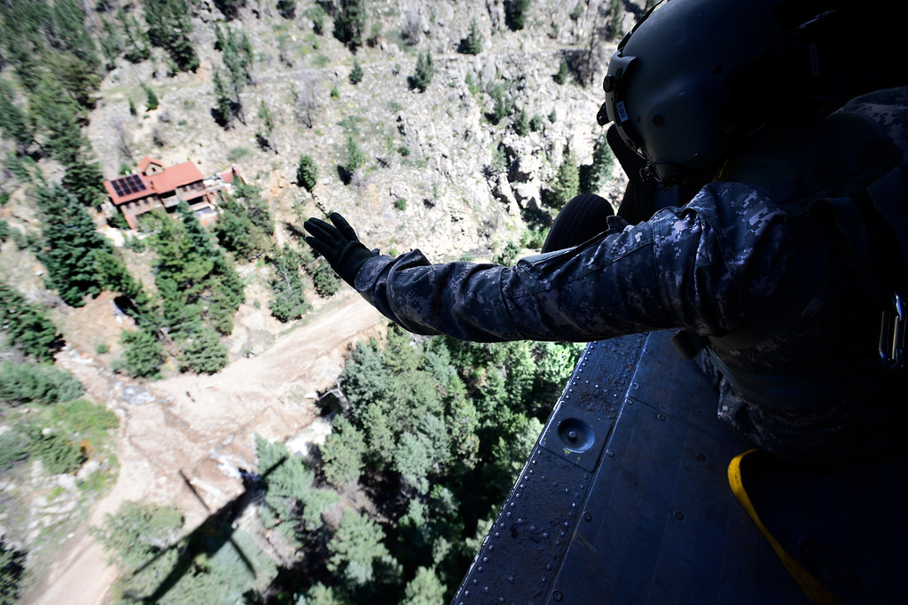 . Staff Sgt Jose Pantoja searches for people cutoff by flood waters in the foothills of Boulder and Longmont Colorado including Jamestown Colorado. The helicopter was flown by the 2-4 GSAB 4th Infantry Division based in Ft. Carson Colorado. Tuesday September 17, 2013. BOULDER DAILY CAMERA/ Mark Leffingwell Leffingwell