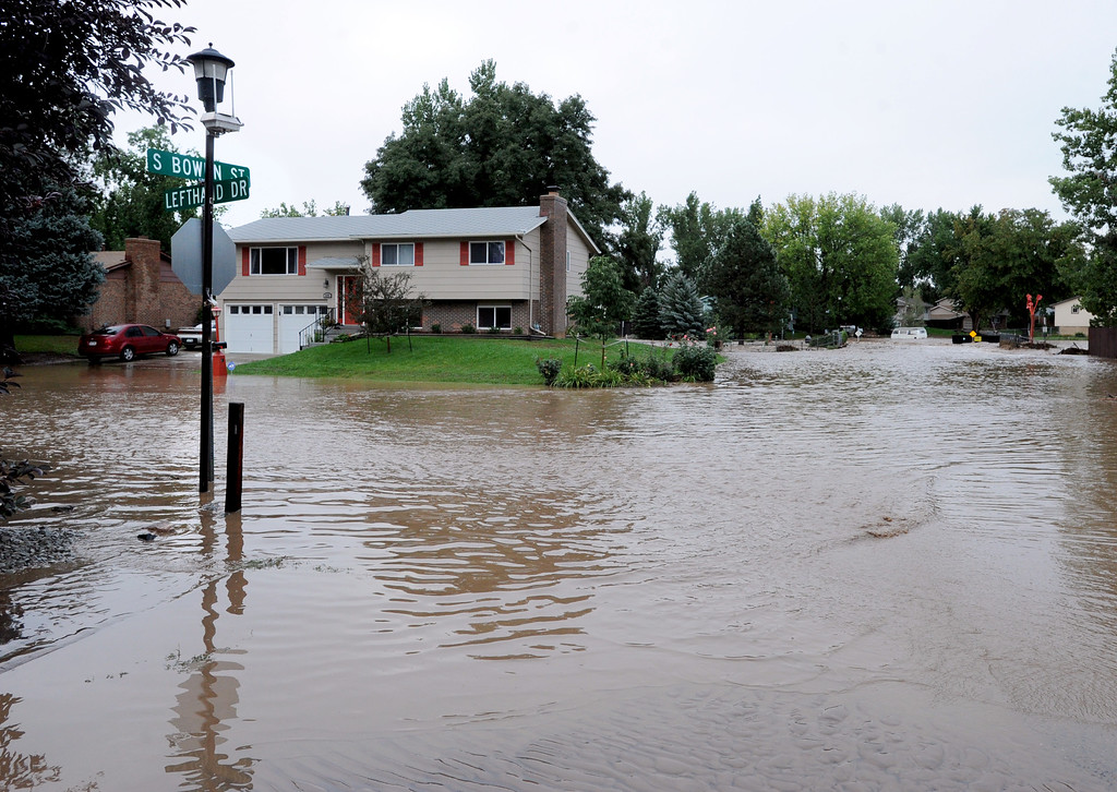. Lefthand Creek in Longmont has flooded a block in each direction on S. Bowen Street on Friday. For more flooding videos and photos, www.dailycamera.com. Cliff Grassmick  / September 13, 2013