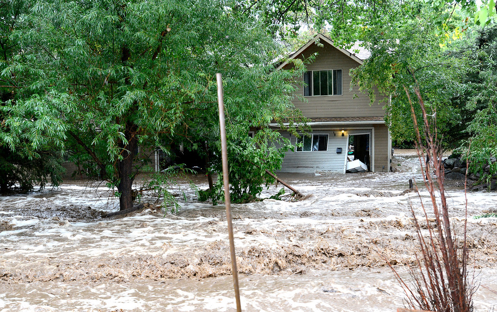 . Water runs through a home at 19th and Upland Ave as heavy rains cause severe flooding in Boulder, Colorado September 12, 2013. BOULDER DAILY CAMERA/ Mark Leffingwell