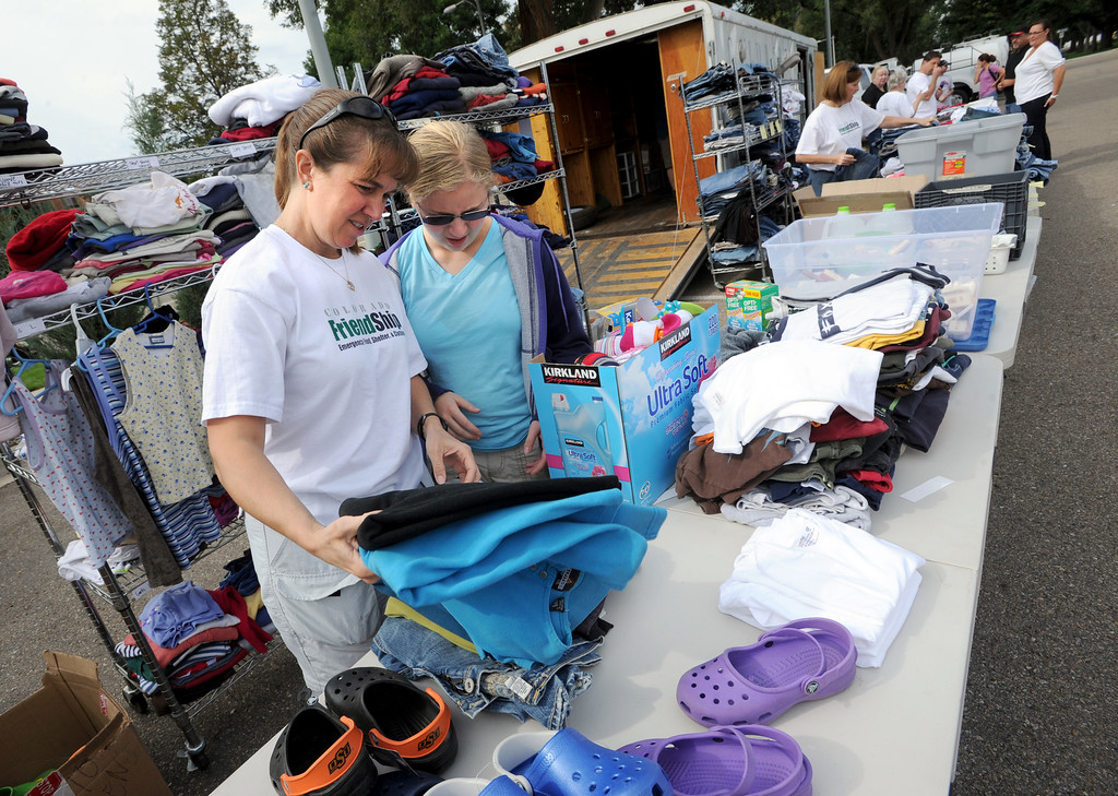. Liz Friedenson, left, and her daughter, Rachel, both of Colorado Friendship, sort clothes that are available to flood victims in Longmont, CO, on September 14, 2013. They are located at Roosevelt Park at Terry Street and LongsPeak. Cliff Grassmick / September 14, 2013