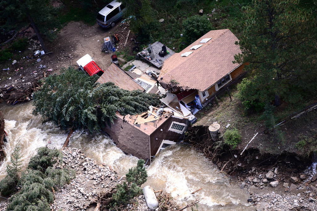 . A rescue helicopter flies over Jamestown Colorado which was hard hit by flood waters. The aircraft was flown by the 2-4 GSAB 4th Infantry Division based in Ft. Carson, Colorado.  September 17, 2013. BOULDER DAILY CAMERA/ Mark Leffingwell