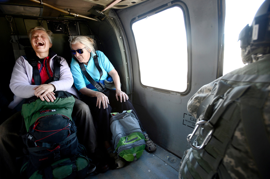 . Two women smile and laugh after rescued by a helicopter crew from Jamestown Colorado that was cut off by flood waters. The helicopter was flown by the 2-4 GSAB 4th Infantry Division based in Ft. Carson Colorado.  September 17, 2013. BOULDER DAILY CAMERA/ Mark Leffingwell
