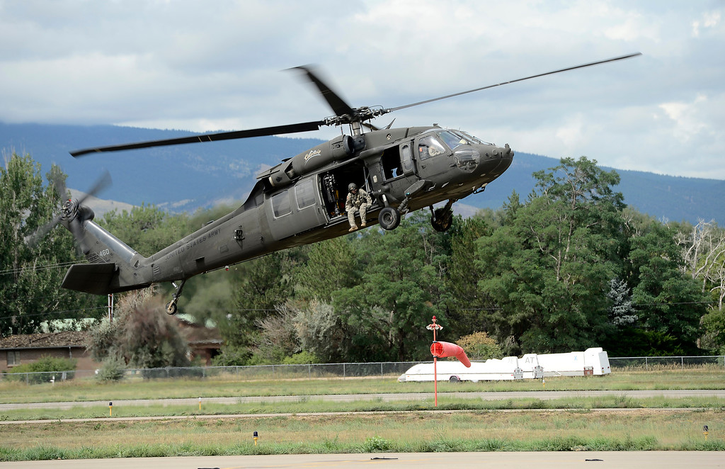 . A National Guard helicopter lands at Boulder Municipal Airport after ferrying supplies and rescue personnel to mountain towns that have been cut off by the flooding in Boulder, Colorado September 13, 2013. BOULDER DAILY CAMERA/ Mark Leffingwell