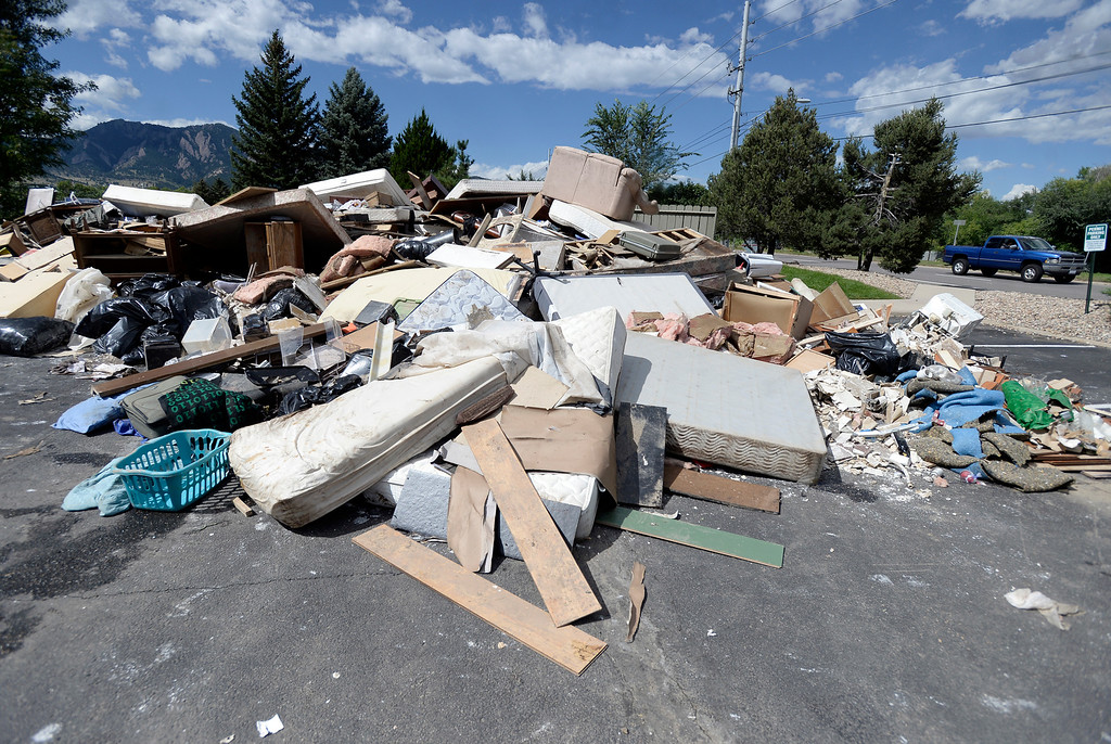 . Piles of flood damaged belongings sit in the parking lot of the Manhattan West Apartments on Wednesday, Sept. 18, in Boulder. For more photos and video of the flood go to www.dailycamera.com Jeremy Papasso/ Camera