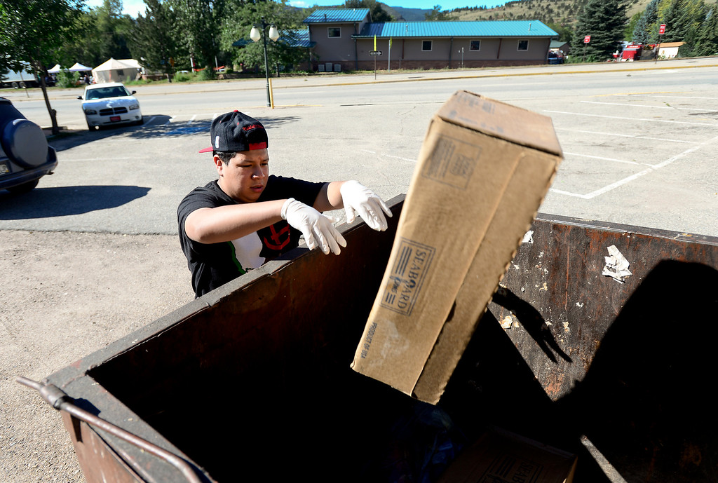 . Smokin\' Dave\'s BBQ and Taphouse bus boy and prep cook Jesus Montes, 15, throws out spoiled meat, Wednesday, Sept. 18, 2013, in Lyons. (Matthew Jonas/Times-Call)