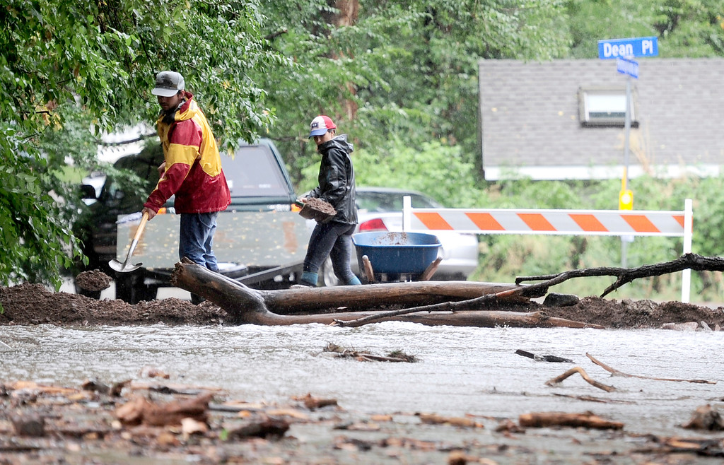 . People use dirt and debris to create dykes helping divert water from their homes as heavy rains cause severe flooding in Boulder, Colorado September 12, 2013. BOULDER DAILY CAMERA/ Mark Leffingwell