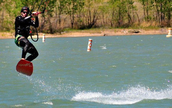 Travis Townes lifts off the water as he parasails at Boulder Reservoir Tuesday. The temperature in the reservoir is still classified as too cold for swimming in the deep area. Photo By Nick Oxford The Daily Camera June 7, 2011.