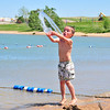 Peyton Davis tosses some water on the beach at the Boulder Reservoir Tuesday. Photo By Nick Oxford The Daily Camera June 7, 2011.