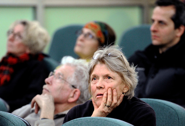 """Boulder County residents Sophia Stoller and her husband Peter Stoller, left, watch the television monitors as they listen to Boulder Police chief Mark Beckner talk about the elk killed by police on Mapleton Hill during a city council meeting on Tuesday, Jan. 8, at the Boulder Municipal building in Boulder. For a video of the dead elk topic at the meeting go to  <a href=""""http://www.dailycamera.com"""">http://www.dailycamera.com</a><br /> Jeremy Papasso/ Camera"""