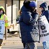 BEN GARVER — THE BERKSHIRE EAGLE<br /> Paratransit drivers with Berkshire Regional Transit Authority walk a picket line after failed contract negotiations over wages. The drivers work for Paratransit Management of the Berkshires, a subsidiary of First Transit, which operates the vehicles for the BRTA. The drivers pick up and drop off people with disabilities.