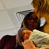 KRISTOPHER RADDER - BRATTLEBORO REFORMER<br /> Maya Fulford, of Guilford, Vt., holds her new baby girl, Adriana Fulford Salimbeni, born on Jan. 2, 2018, at 12:27 p.m., at Brattleboro Memorial Hospital, while her spouse, Sara Salimbeni, looks on before heading home on Thursday, Jan. 4, 2018.