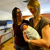 KRISTOPHER RADDER - BRATTLEBORO REFORMER<br /> Maya Fulford, of Guilford, Vt., holds her new baby girl, Adriana Fulford Salimbeni, born on Jan. 2, 2018, at 12:27 p.m., at Brattleboro Memorial Hospital, while her spouse, Sara Salimbeni, looks on before heading home on Thursday, Jan. 4, 2018.