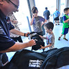 KRISTOPHER RADDER — BRATTLEBORO REFORMER<br /> Randy Wheelock, the service manager at Auto Mall,  hands out a backpack to Ryder Lao, 4, during the Back to School event on Aug. 20, 2019.