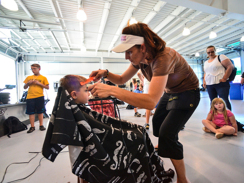 KRISTOPHER RADDER — BRATTLEBORO REFORMER<br /> The Brattleboro Reformer partnered with the Auto Mall and the United Way of Windham County to provide backpacks and school supplies to school age children in Windham County on Tuesday, Aug. 20, 2019. The crew from Shear Design Hair Studio provided free haircuts at the event.