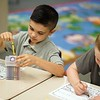BEN GARVER — THE BERKSHIRE EAGLE<br /> First grader David Maloy, age 6, chooses a yellow crayon to start the school year on  first day of School at Stearns Elementary School in Pittsfield, Mass., Tuesday, September 3, 2019.