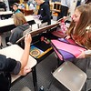 BEN GARVER — THE BERKSHIRE EAGLE<br /> Ethan Bishop, 10, helps Gabriella Leach-Hinkley, 10, get her supplies into her desk on the  first day of School at Stearns Elementary School in Pittsfield, Mass., Tuesday, September 3, 2019. The fifth graders are in Andy Mickle's class.