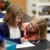 BEN GARVER — THE BERKSHIRE EAGLE<br /> Cousins Jordyn Mlynarczyk (left) and Hayden Hacker, both age 7, share a moment in Rebecca Vanderstelt's art class at Stearns Elementary School on the first day of School, Tuesday, September 3, 2019.