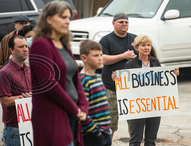 About 40 people gathered this morning, Friday, April 17, 2020 at the Wood County Courthouse in Quitman, Texas to protest their stay-at-home order and its effect on the local economy.