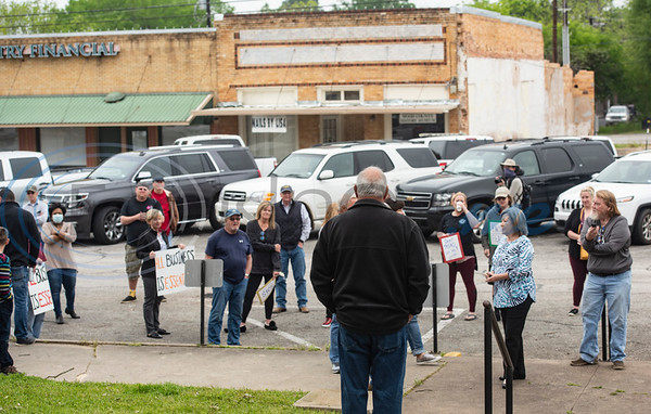 Mineola Community Bank President Jim Herlocker leads rally of people who want to see business restrictions loosened in sight of the stay-at-home order and its effect on the local economy at the Wood County Courthouse in Quitman, Texas on Friday, April 17, 2020. About 40 people attended the event.