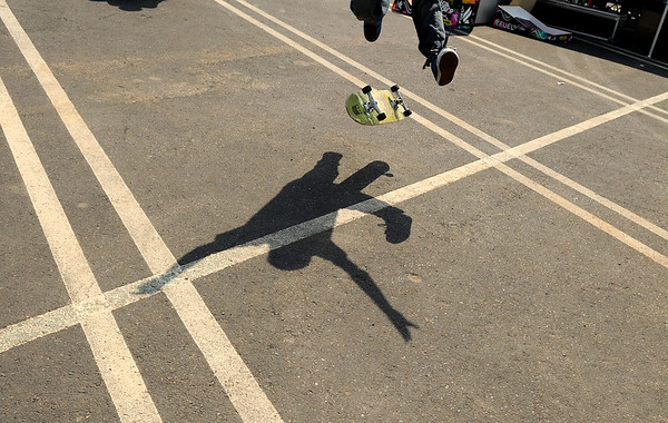 "Justice Martinez, 15, of Brighton, does a kickflip while skating with friends at the Backyard BBQ Tour at the Flatiron Crossings mall in Broomfield on Saturday, June 4. For more photos and video of the event go to  <a href=""http://www.dailycamera.com"">http://www.dailycamera.com</a><br /> Jeremy Papasso/ Camera"