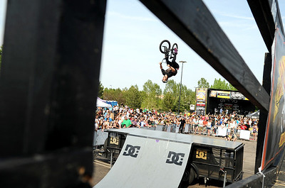 Pro BMX rider Allen Cook throws down a trick for the crowd during the Backyard BBQ Tour at the Flatiron Crossings mall in Broomfield on Saturday, June 4. For more photos and video of the event go to www.dailycamera.com Jeremy Papasso/ Camera
