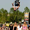 "Pro BMX rider Mike ""Hucker"" Clark throws a backflip over spectators during the Backyard BBQ Tour at the Flatiron Crossings mall in Broomfield on Saturday, June 4. For more photos and video of the event go to  <a href=""http://www.dailycamera.com"">http://www.dailycamera.com</a><br /> Jeremy Papasso/ Camera"