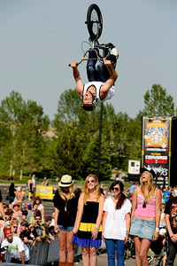 "Pro BMX rider Mike ""Hucker"" Clark throws a backflip over spectators during the Backyard BBQ Tour at the Flatiron Crossings mall in Broomfield on Saturday, June 4. For more photos and video of the event go to www.dailycamera.com Jeremy Papasso/ Camera"