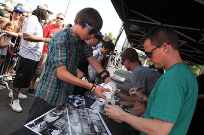 Lewis Marshall, 14, of Broomfield, gets his headphones signed by Pro skater Rob Dyrdek during the Backyard BBQ Tour at the Flatiron Crossings mall in Broomfield on Saturday, June 4. For more photos and video of the event go to www.dailycamera.com Jeremy Papasso/ Camera