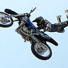 """Metal Mulisha team member Nick Dunne shows his skills during the freestyle moto demonstration at the Backyard BBQ Tour at the Flatiron Crossings mall in Broomfield on Saturday, June 4. For more photos and video of the event go to  <a href=""""http://www.dailycamera.com"""">http://www.dailycamera.com</a><br /> Jeremy Papasso/ Camera"""