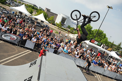 A pro BMX rider does a backflip over a ramp during the Backyard BBQ Tour at the Flatiron Crossings mall in Broomfield on Saturday, June 4. For more photos and video of the event go to www.dailycamera.com Jeremy Papasso/ Camera