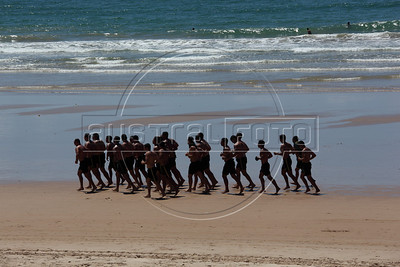 Members of Brazil's Federal National Force train on the beach in Salvador, Bahia state. Hundreds of the police force agents are in the city as the local state police are on strike. (Australfoto/Douglas Engle)