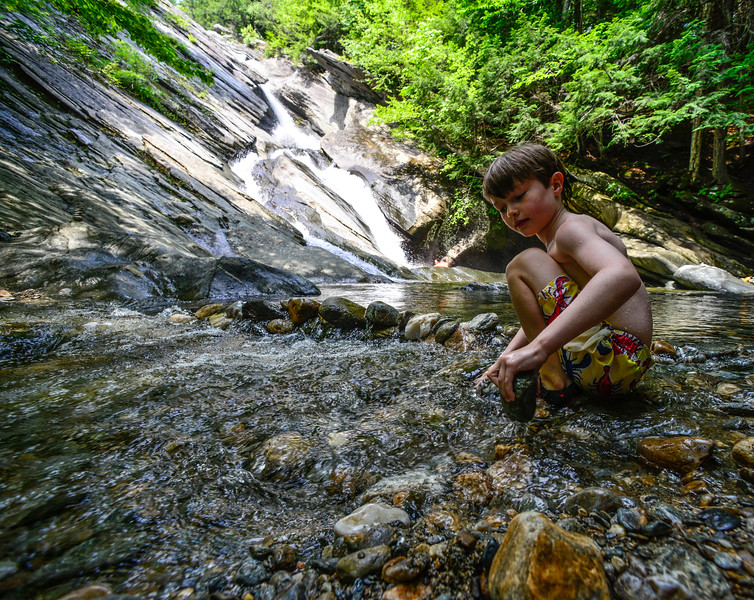 KRISTOPHER RADDER — BRATTLEBORO REFORMER<br /> Andrew Herg, 7, from Tolland, Conn., makes a dam out of rocks at Hamilton Falls, in Jamaica, Vt., on Tuesday, Aug. 7, 2018.
