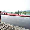 KRISTOPHER RADDER — BRATTLEBORO REFORMER<br /> David Gessner, of Guilford, prepares his single race shell on the West River on Monday, Aug. 6, 2018.