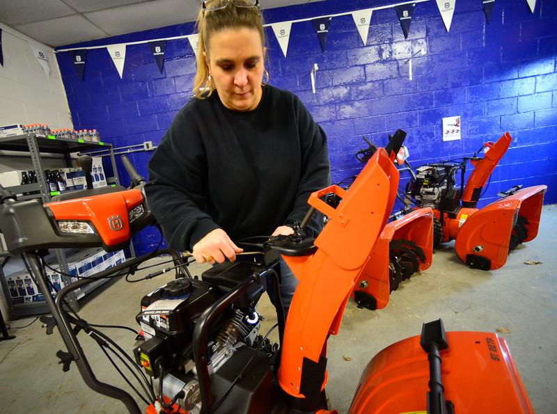 KRISTOPHER RADDER — BRATTLEBORO REFORMER<br /> Elaine Judd, owner of Judd's Power Equipment, in Westminster, assembles a new snowblower to prepare for winter on Thursday, Nov. 14, 2019.