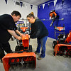 KRISTOPHER RADDER — BRATTLEBORO REFORMER<br /> David and Elaine Judd, owners of Judd's Power Equipment, in Westminster, assemble a new snowblower to prepare for winter on Thursday, Nov. 14, 2019.