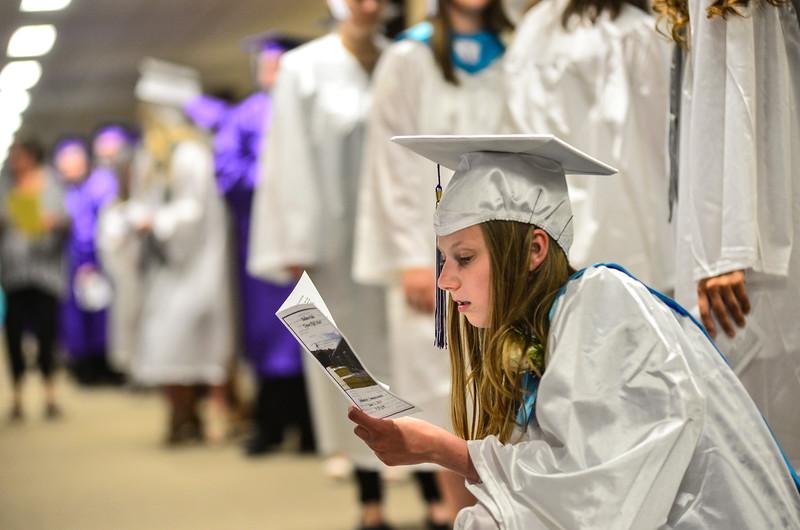 KRISTOPHER RADDER — BRATTLEBORO REFORMER<br /> Lia Clark reads the graduation program before the start of the 2019 Bellows Falls Commencement Ceremony on Thursday, June 13, 2019.